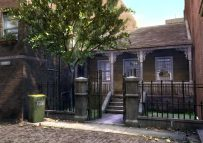 Frame of house in alley way for English animated TV series