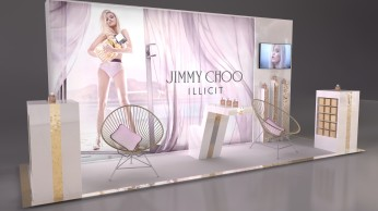 display stand with large graphic, chairs, tv and perfume bottles