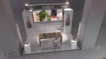 Jurlique stand with table, chairs, product and back illumination
