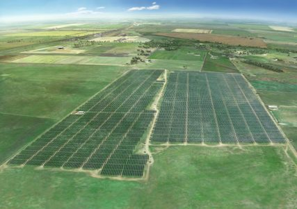 Aerial view of solar fields in farmland
