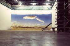 Large warehouse wall size painted sky canvas in studio