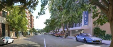 Street with trees, apartment buildings and cars